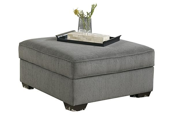 "The Loric - Smoke Storage Ottoman from Ashley Furniture HomeStore (AFHS.com). The ""Loric-Smoke"" upholstery collection features the stylish look of sweeping set-back arms along with the welt accented box seating and back cushions surrounded with a soft chenille upholstery fabric creating a beautiful contemporary styled sectional that offers the comfort you deserve."