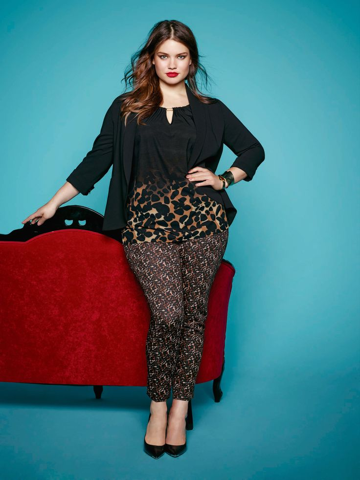 Plus size model Tara Lynn wearing leopard print top and pants and open blazer. Available at Addition Elle.