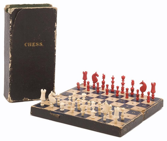 Chess set used during the Civil War by District Judge Henry G. Hicks  of Minneapolis, Minnesota, who served as a First Lieutenant with the  93rd Illinois Regiment. One white pawn is missing from the set.  The  collapsible board folds along a central seam, allowing both it and its  chessmen to fit into the matching box.1870S Chess, Chess Sets