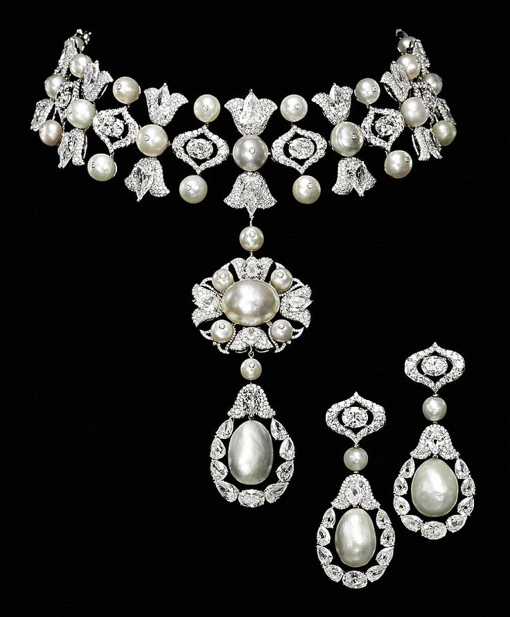 A MAGNIFICENT SUITE OF NATURAL PEARL AND DIAMOND JEWELLERY, BY BOGH-ART