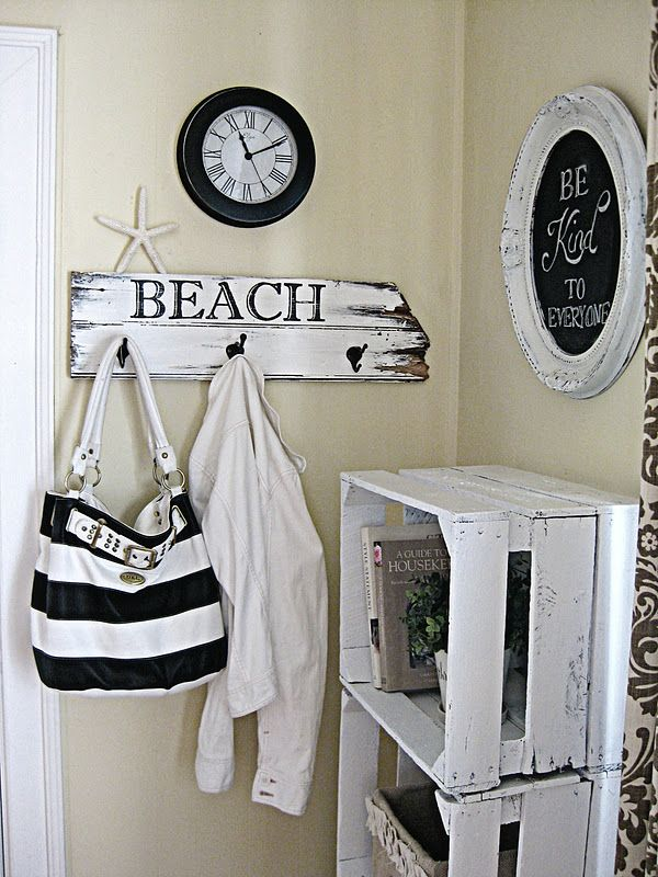 """Beach"" sign w/ hooks.  Great idea for beach theme in bathroom too."