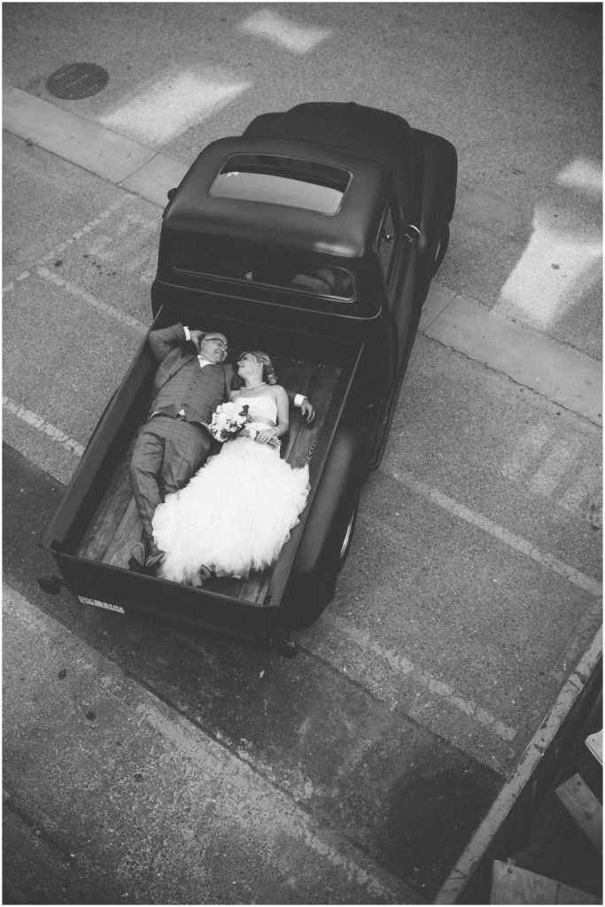Bride and Groom in the back of a vintage 1951 Ford Pickup Truck \ Joelsview Photography