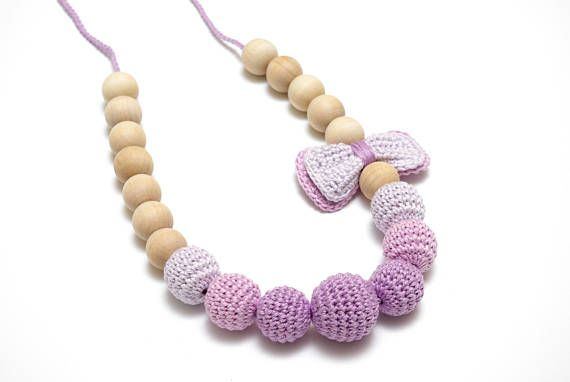 purple crochet nursing necklace made by #RedOgeeSheep #sensorytoy #montessoritoy #newborntoy #mommyandme