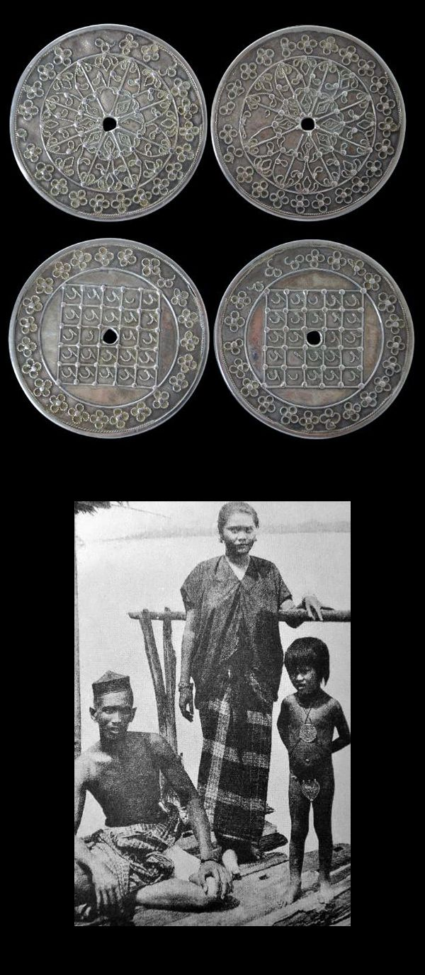 Indonesia | Matching Pair of Silver & Filigree Islamic Talismanic Disks (Kawari).  Diameter 7.5 cms | Bugis People, South Sulawesi | ca. 19th century | Price on Request || The Bugis child on the far right in this early photograph wears a kowari disk on her chest. A matching disk would be on her back. The pubic cover is a caping, also made of silver.