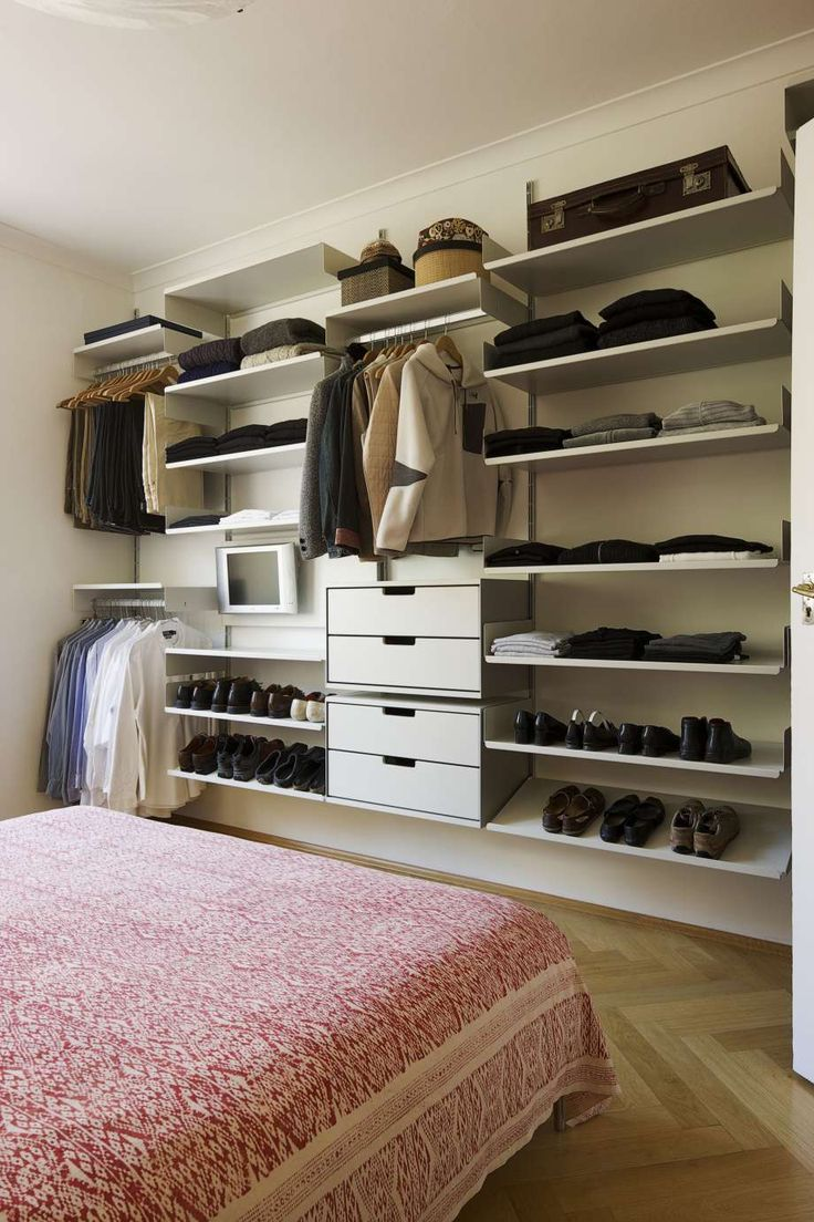 The shoes, clothes and hat storage solution for your bedroom. Note the hanging rails for shirts and trousers. Even the TV is squeezed in for bedtime viewing. www.vitsoe.com