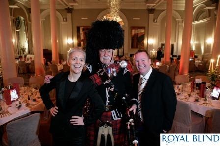 Our hosts for the evening Karen Dunbar and Paul Riley with our piper Jim