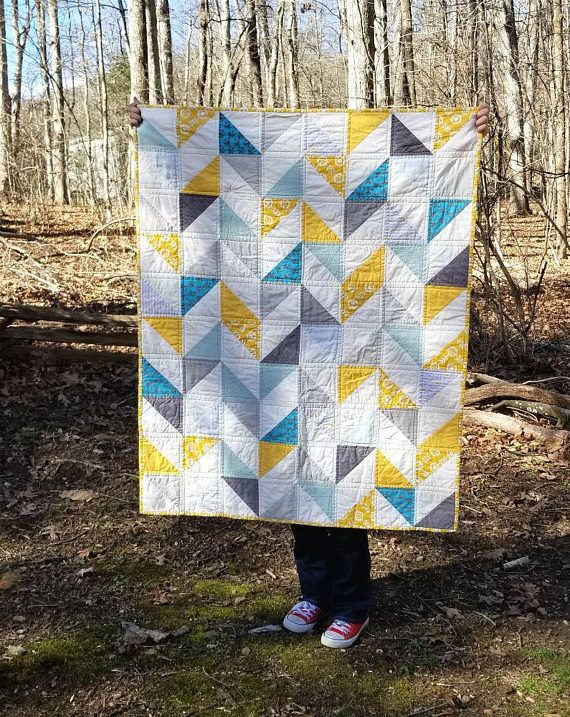 This is a ready to ship, yellow + gray + turquoise baby/toddler quilt. When you invest in a beautifully crafted quilt, it is a gift that will become an heirloom one day. This particular quilt measures 40x50, a generous size for a baby to grow into or simply use as a tummy time mat.