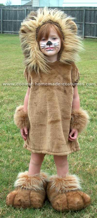 Lion costume - brown hoodie with a band of fake fur around the front and fabric ears sewn on.  Add fur wristlets and anklets over brown boots. gloves with plastic nails hot glued on.
