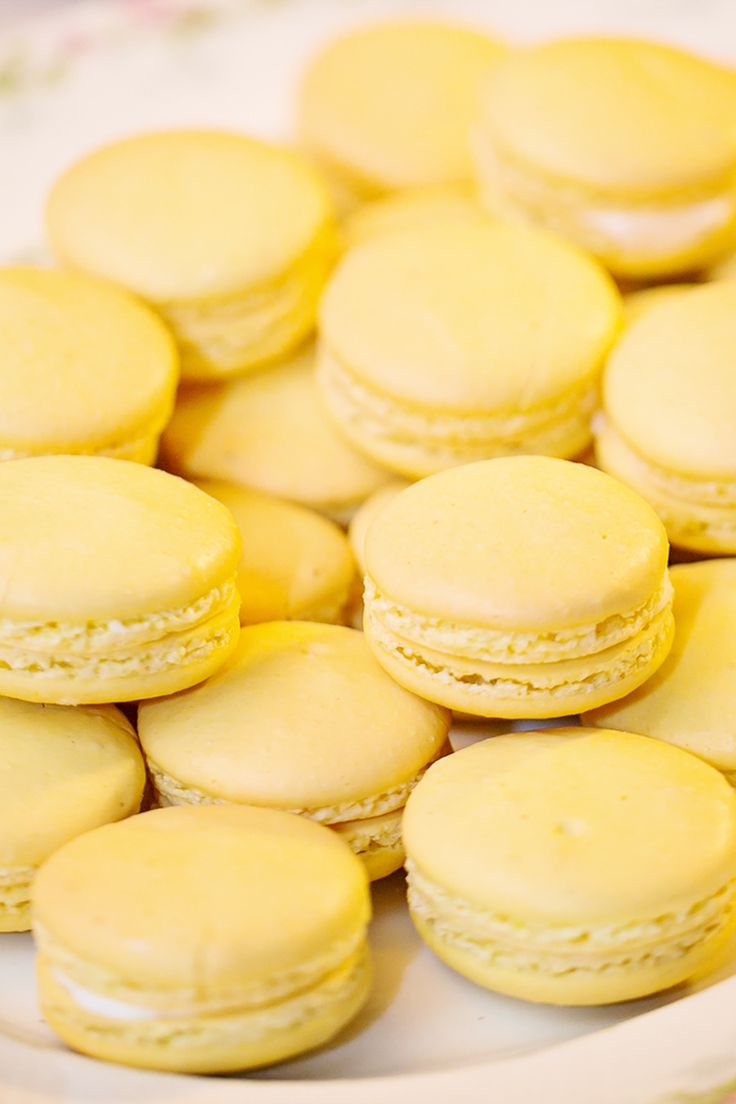 Yellow Macarons -- Been missing yellow! See the wedding on #smp here: http://www.StyleMePretty.com/little-black-book-blog/2014/04/15/vintage-orlando-lake-lucerne-wedding/ Photography: Claudette Montero From AlucinarteFilms.com