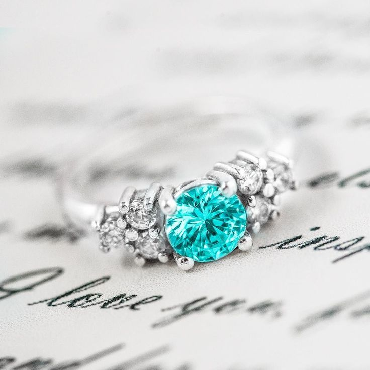 There's something so magical about a mint-colored gem! How would you personalize this beautiful ring? Link in bio! . . . #jewelry #ring #mint #swarovski #sparkle #engagementring #promisering #silver #gold #photography http://jwl.io/45a58
