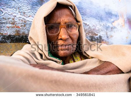 Rajasthan, India. March 2012. An unidentified Indian old woman in beige shawl