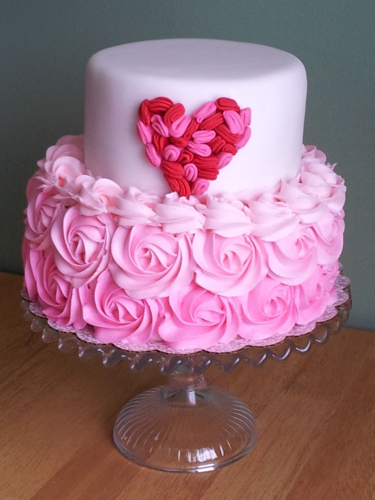 Heart Ruffle Cake - Inspired by: http://www.projectwedding.com/wedding-ideas/diy-ruffle-heart-cake/1    Bottom tier pink ombre buttercream, top red & pink ruffles