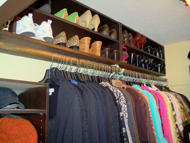 Add a shoe racks to the top shelf of the closet to store out of season shoes.