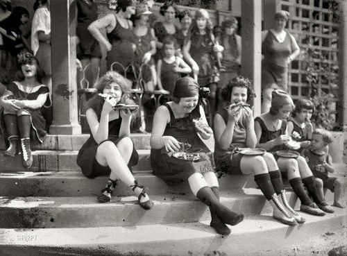 In 1921, early suffragettes often donned a bathing suit and ate pizza in large groups to annoy men…it was a custom at the time