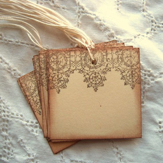 Set of 10 tags measuring 2 inches by 2 inches. At the tops of the cream manilla cardstock, I have stamped lace in a cocoa brown. I did this on both sides of the tag. I then hand aged the edges and prestrung them with ivory twine. They are af, lf and archival safe.