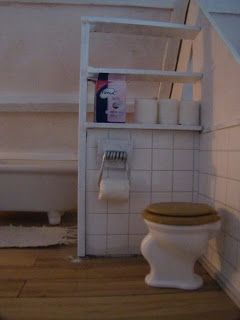 paula's mini's: wc rol houder is ijzer van een wasknijper!