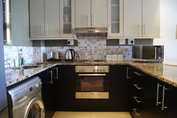 Fully Equipped Kitchen with Modern Marble Tops