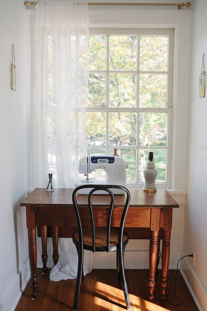 A mama's craft corner, including an antique sewing table.