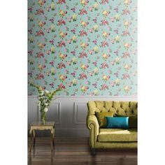 Charmed Teal Multicoloured Wallpaper - The glitter combined with enchanting designs captures light beautifully, giving great depth & texture. This colourful floral wallpaper showcases different elements of the nature at their best