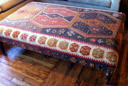 the oversized ottoman | Design Manifest 5′ x 3′ and covered in a kilim rug,