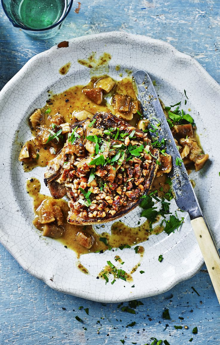 A very easy way with a pork chop using sweet dried figs, walnuts, and white wine.
