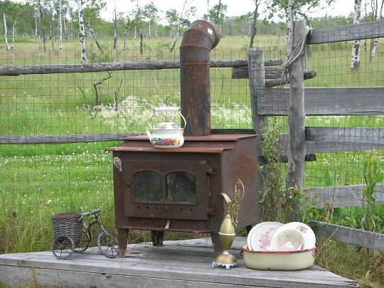 Outside Wood Stoves -- They say this helsp to heat your home. Not sure how, but interesting to check into.