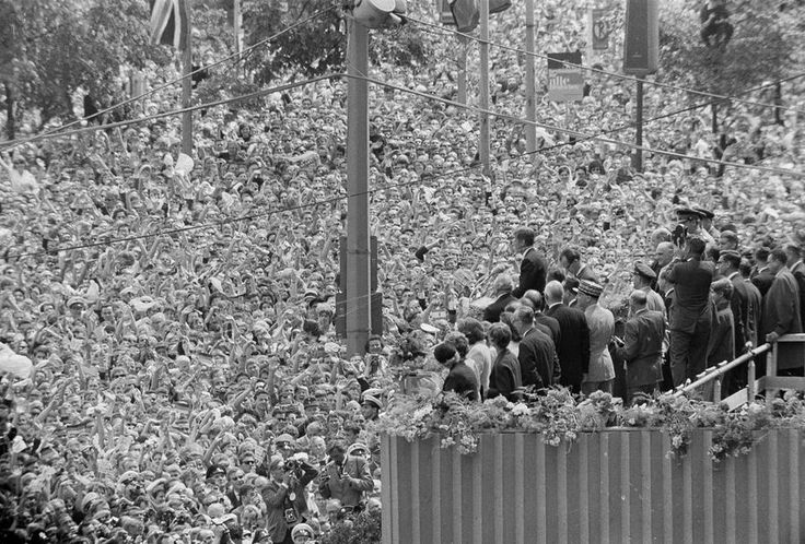 50 Years Ago: The World in 1963 - A cheering crowd, estimated by police at more than a quarter of a million, fills the area beneath the podium at West Berlin's City Hall, where U.S. President John F. Kennedy stands. His address to the City Hall crowd was one of the highlights of his career.