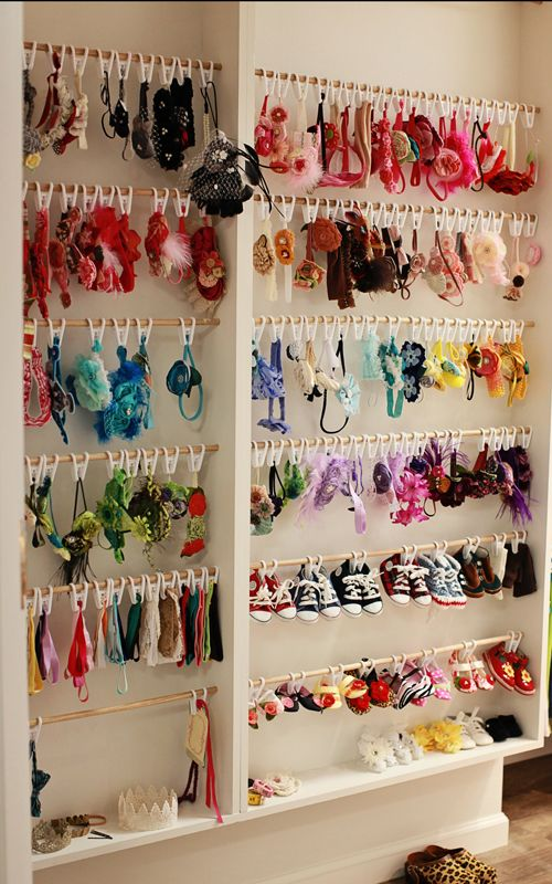 A great way to store all of my hair pretties for my girls. I love that they hang the cute, little, baby shoes, too!
