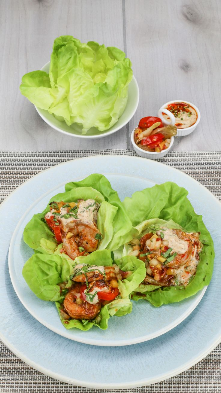 BBQ Shrimp Lettuce Wrap $9.99 | BBQ spiced & pan seared shrimp wrapped in bibb lettuce cups, served with roasted sweet onion and topped with tomato-peach relish and spicy remoulade for a low-carb take on a po' boy, full of seasonal Midwest flavor. Served with a side of quinoa-kale salad dressed in basil vinaigrette. #BBQ #shrimp #eatpurely #healthyliving