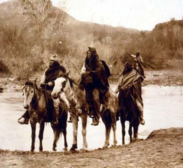 Here for your perusal is an original photograph of Ford. It was created in 1903 by Edward S. Curtis.    The photograph illustrates Four Apache men on horseback at the edge of a stream.    We have compiled this collection of photographs mainly to serve as a valuable educational resource. Contact curator@old-picture.com.