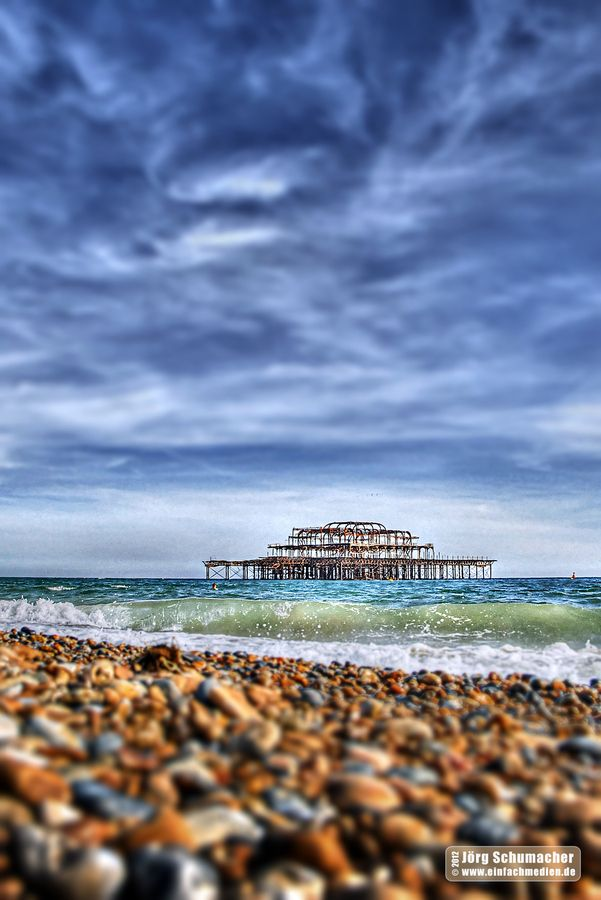 Brighton Pier, England. The skeleton of the old pier that burnt down. Such conspiracy! :-) OH, I brought home a ton of these little rocks from the shore. It's so strange seeing a beach without sand. <3