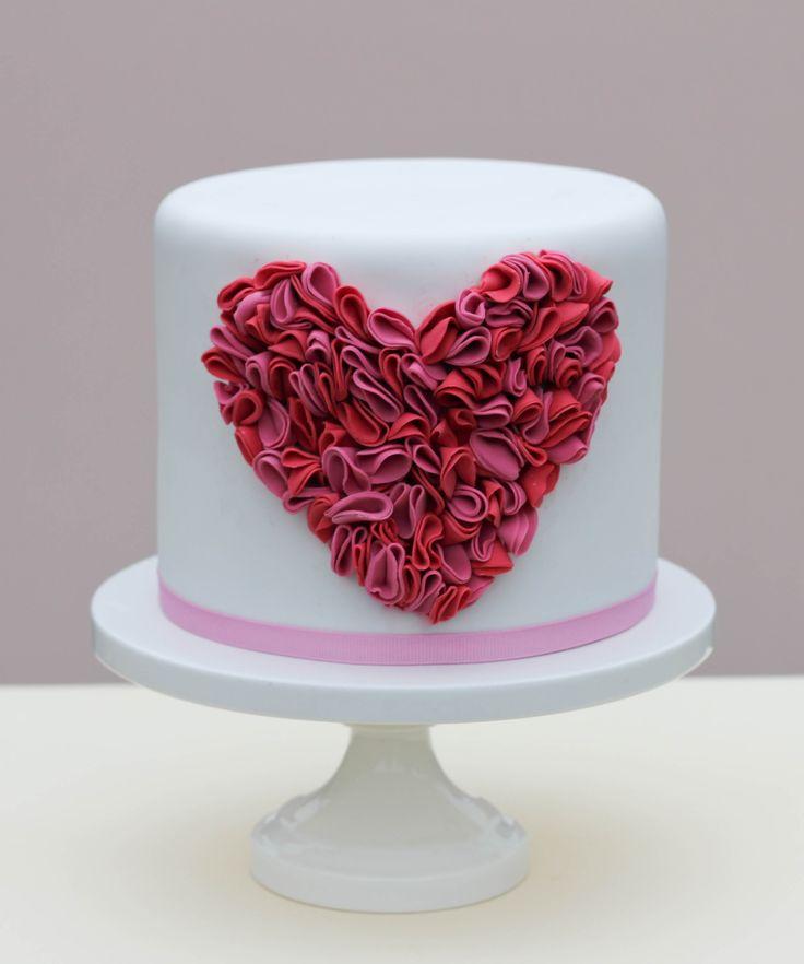 Valentine's Day - Single-tier fondant covered cake with fondant ruffle heart. DIY tutorial on Project Wedding (http://www.projectwedding.com/wedding-ideas/diy-ruffle-heart-cake/1?sd=5000=1)