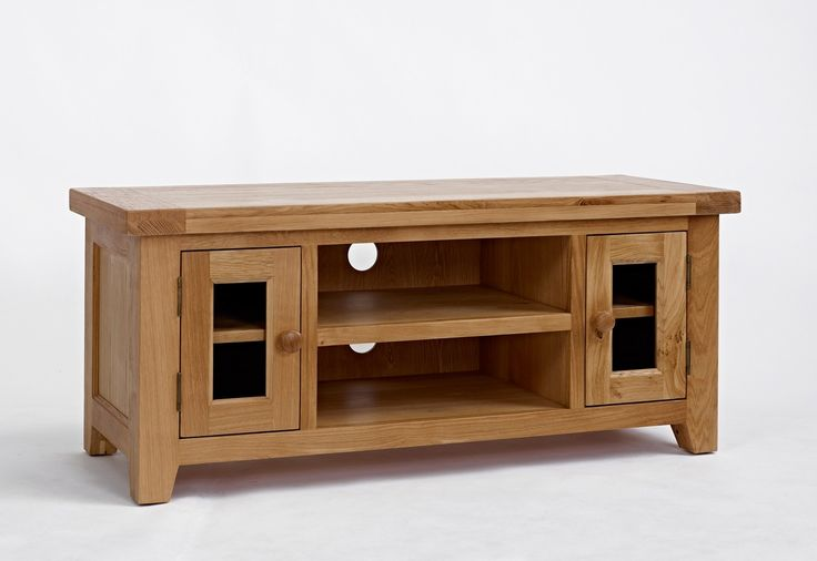 Devon Oak Large TV Unit - The Devon Oak Large TV Unit would blend with a vast range of interior settings and would be a versatile investment for any home. Crafted using traditional methods, this piece features unique tapered leg ends with floor protectors under each.