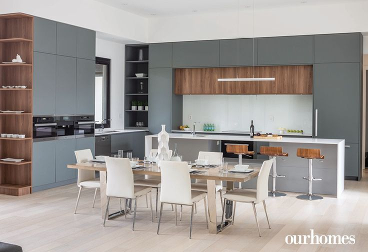 """Warm walnut and grey in the kitchen proves that modern doesn't have to be austere.     See more of this home in """"Modern Love on Burlington's Park Avenue"""" from OUR HOMES Oakville Summer 2016  http://www.ourhomes.ca/articles/build/article/modern-love-on-burlingtons-park-avenue"""