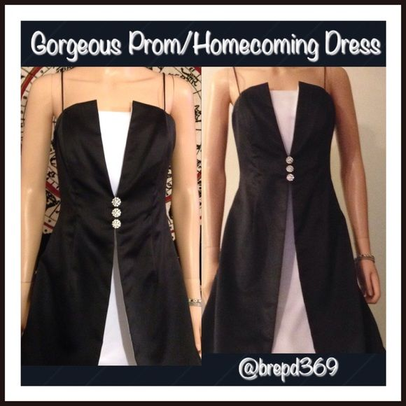 Stunning Prom Dress Add matching earrings to bundle for closet discount! Great for Prom! Absolutely STUNNING white/black Prom/Homecoming dress! Wear w/straps tucked in or as is! Hourglass dress w/3 rhinestone embellishments at center, long ankle length dress! Small mark on left side, see last pic, a small hole on right bust. Was $30-Reduced price ✅Bundles ✅Offers (button please) ✅Ask Questions Trades PayPal Holds (BD31) Dresses