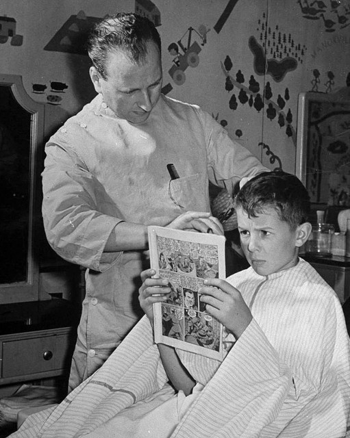 A comic book to take his mind off the haircut.