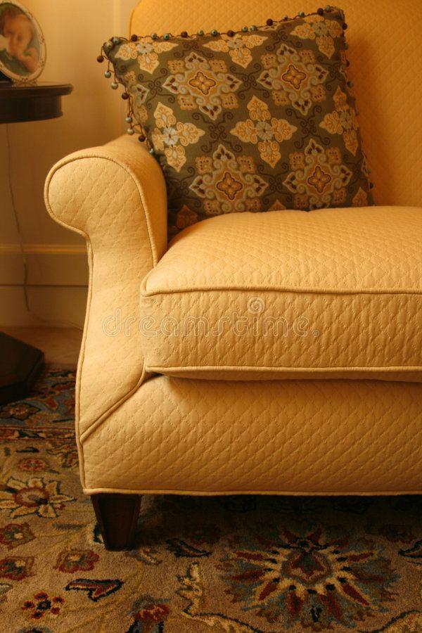 Gold sofa, pillow and carpet. Gracious golden sofa, brown