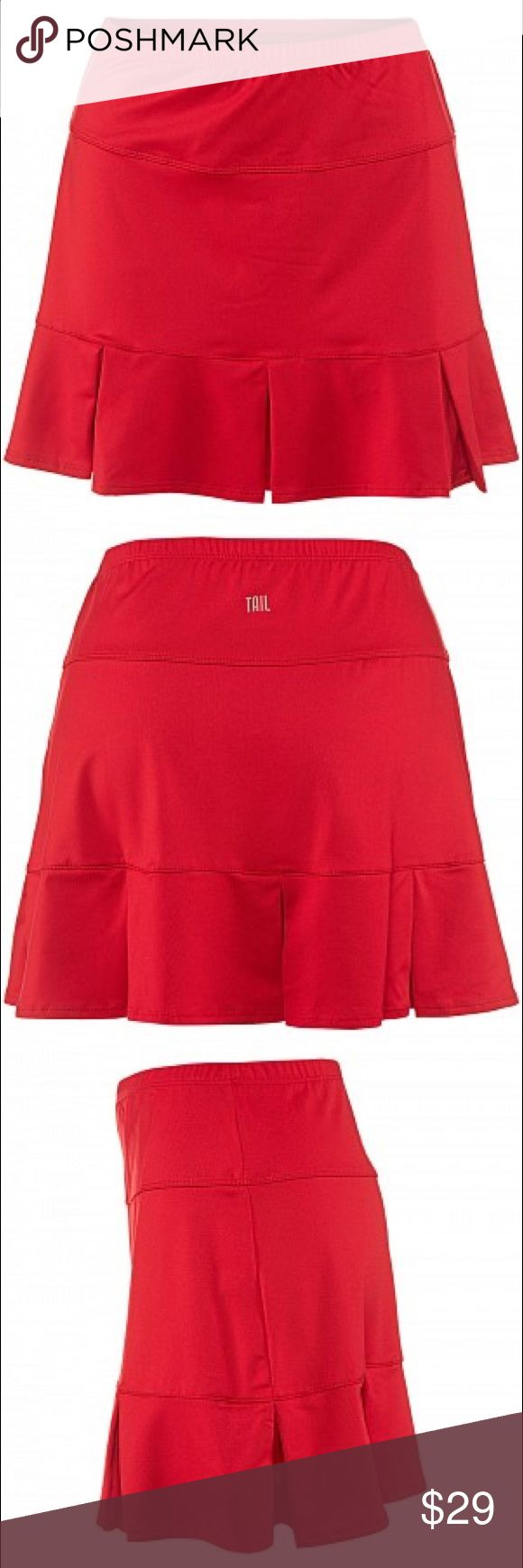 {Tail} Tennis Skirt Offers Welcome  Tail Red Doral Pleated Tennis Skirt, Size Medium  Boost your game and style this season with the perfect outfit. The Tail Doral Skirt features an elastic waistband, built-in short with mesh ball pockets, cute contrast pleating on hem, UV protection, and heat transfer Tail logo on back waist. Content: 92% Polyester, 8% Spandex. Colors: Red  All items come from a smoke free, dog friendly home.  C Tail Skirts