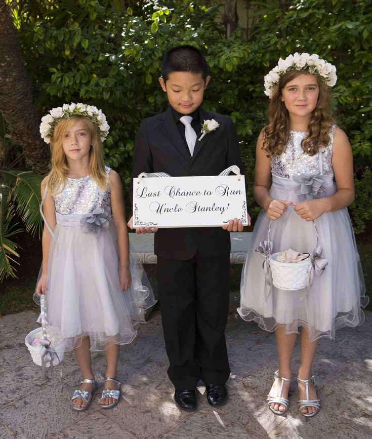 If you have a few adorable kids in your family, chances are you've already selected your flower girl and ring bearer. But if youhavea bevy of little ones you'd like to include in your ceremony, it can be tough to figure out what roles they can each play. Older kids may enjoy handing out programs or serving as junior bridesmaids and groomsmen, but these types of jobs may be overwhelming for the younger set. A charming alternative is to ask one or two kidsto carry a hand...