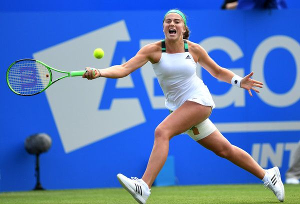 Jelena Ostapenko Photos Photos - Jelena Ostapenko of Latvia hits a backhand during the ladies singles round of 16 match against Johanna Konta of Great Britain on day five of the Aegon International Eastbourne at Devonshire Park Lawn Tennis Club on June 29, 2017 in Eastbourne, England. - Aegon International Eastbourne - Day 5