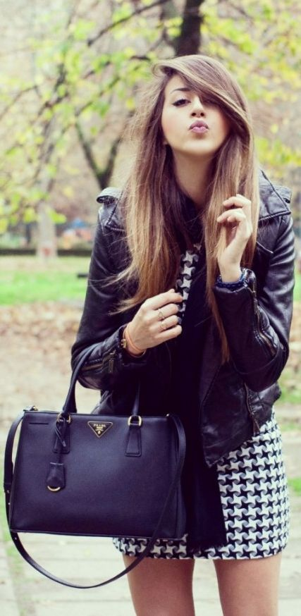 patterned dress, leather jacket and Prada