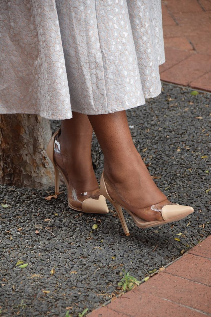 Nude court shoes with perspex clear sides and heart detail in the front.