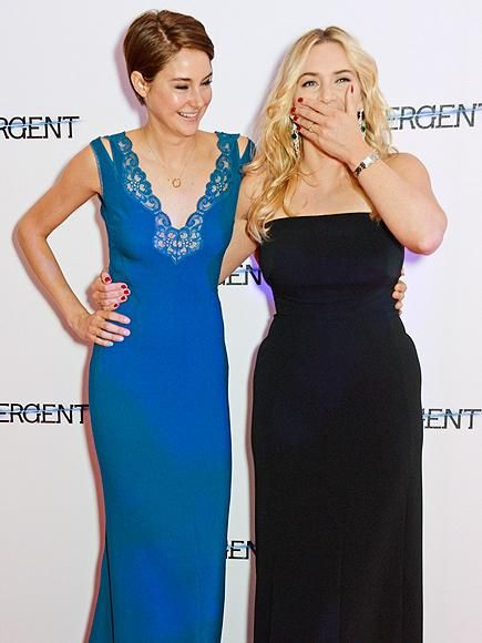 What's so funny? Shailene Woodley and Kate Winslet share the spotlight – and a joke! – at the London premiere of Divergent. http://www.people.com/people/gallery/0,,20801293,00.html#30126759