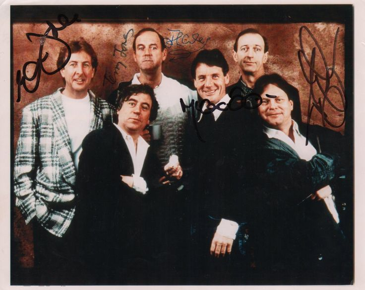 MONTY PYTHON: Signed colour 10 x 8 photograph, the image depicting six members of the comedy team, Monty Pythons Flying Circus, standing as a group, in three-quarters length pose. Signed by Terry Gilliam, John Cleese, Michael Palin, Terry Jones and Eric Idle, to clear areas of the image, Palins being to a darker area, but still legible.