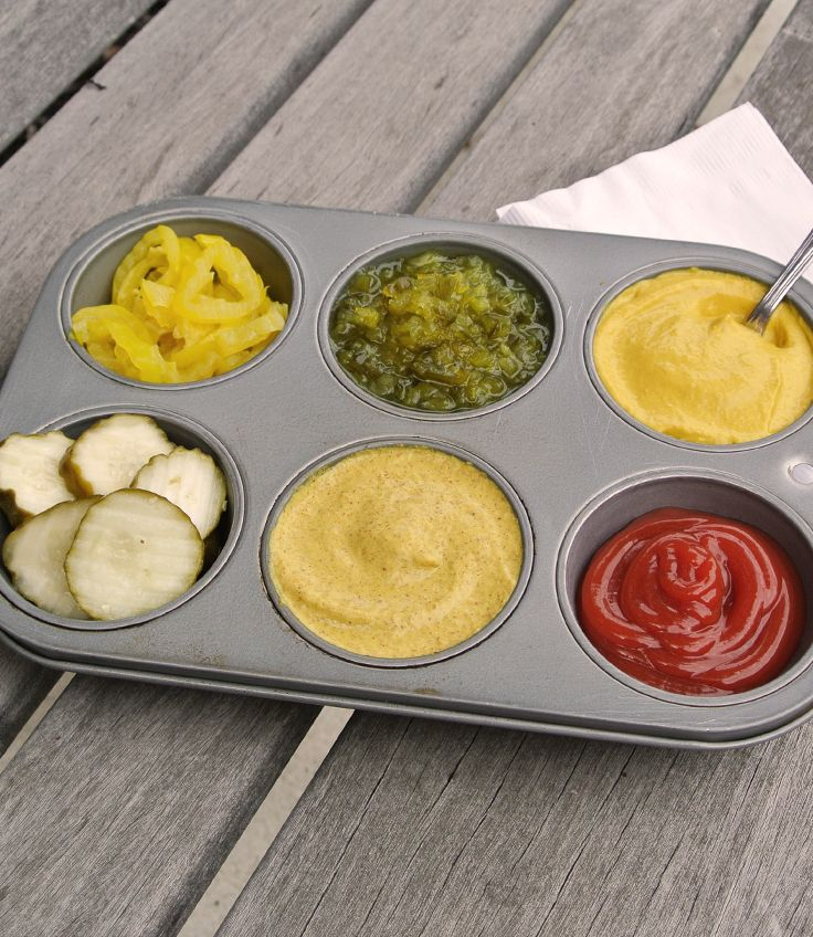 Grilling Tip - Put condiments in a muffin tin. No more toting bottles & jars to the picnic table!