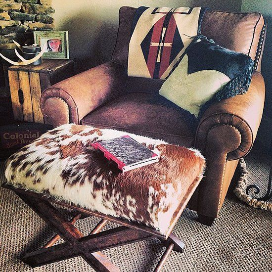 Cowhide X bench as an ottoman or use as a small bench in a walk in closet. Similar here: http://rusticartistry.com/product/cowhide-bench/