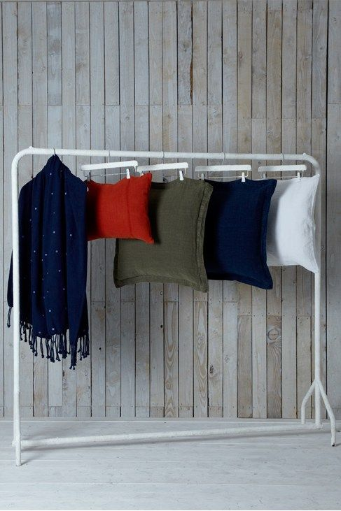 Love how these cushions are displayed. Great displaying idea for market/shop or photo - painted trouser hangers from Ikea on a cheap rail!