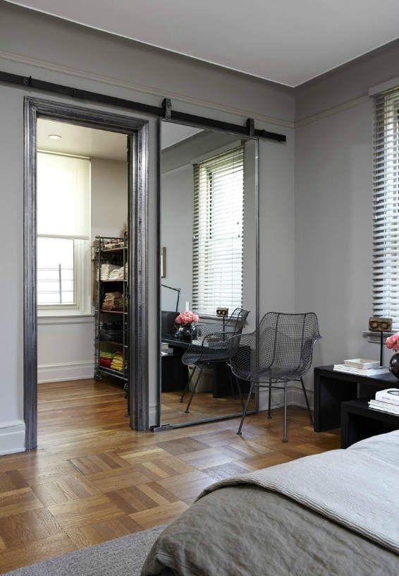 mirrored barn door - photo via http://www.jodykivort.com/ - beautiful, practical way to hide closet without having a door disrupt the space #style #design #homestyle