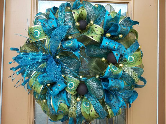 Hey, I found this really awesome Etsy listing at https://www.etsy.com/listing/164505195/deco-mesh-green-and-teal-peacock-wreath