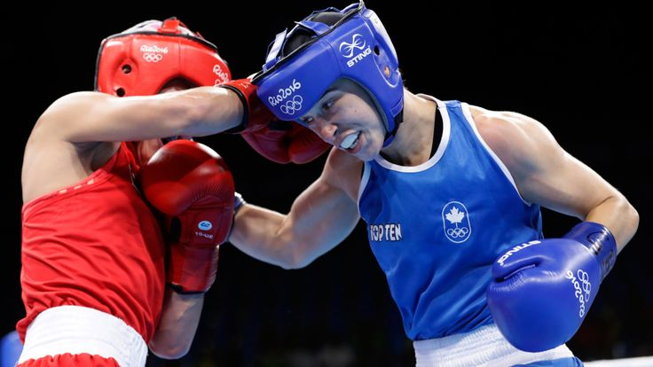Canada's Mandy Bujold, right, fights Uzbekistan's Yodgoroy Mirzaeva during a women's flyweight 51-kg preliminary boxing match at the 2016 Summer Olympics in Rio de Janeiro, Brazil, Friday, Aug. 12, 2016. (AP Photo/Frank Franklin II)  (1200×675)